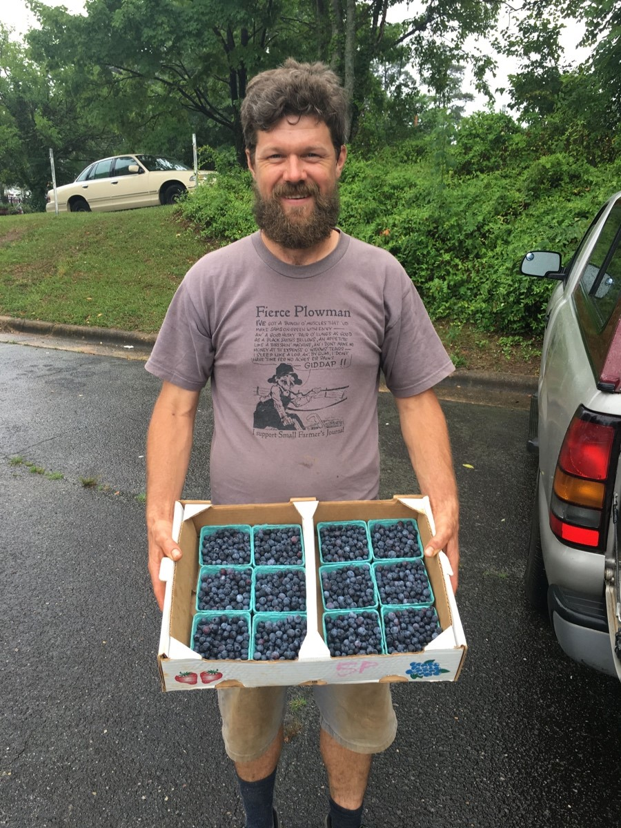 Image of man holding berries